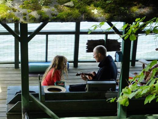 Boy and uncle on boathouse