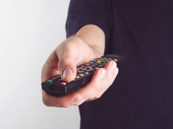 Male-Hand-TV-Remote